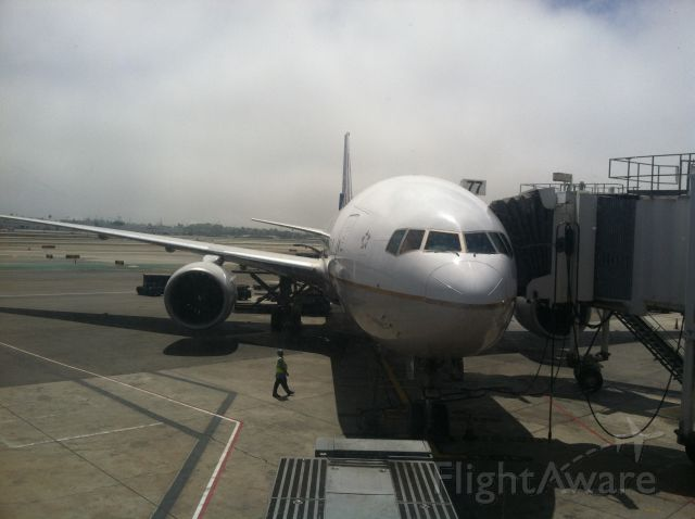 Boeing 777-200 (N778UA) - Just exiting the aircraft at LAX terminal 8 from a flight from London Heathrow.