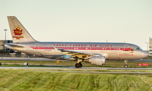 Airbus A319 (C-FZUH) - Portrait shot of the Air Canada retro taxiing for a 06L departure.