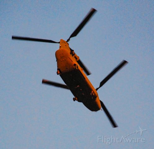 — — - Chinook helicopter flying over Simpsonville just before sunset.