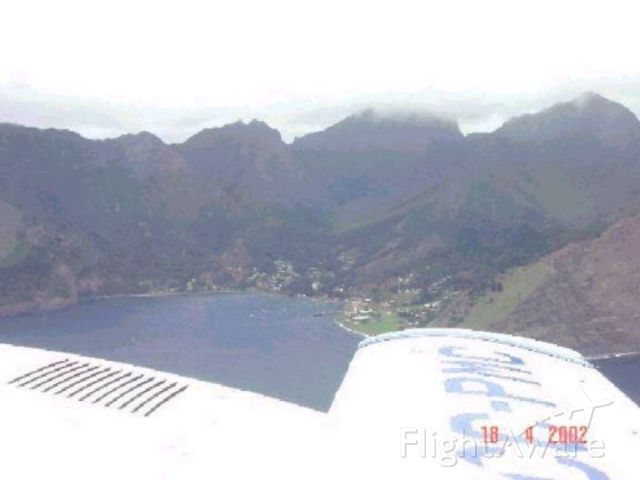 CC-PCN — - Circling Juan Fernández Island (Robinsoe Crusoe) before landing. Only inhabited village visible in bay.