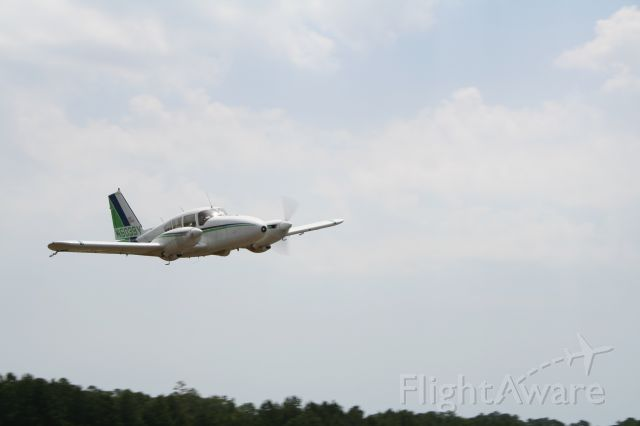 Piper Apache (N6039Y) - Picture was taken during nozzel calibration for misquito control.