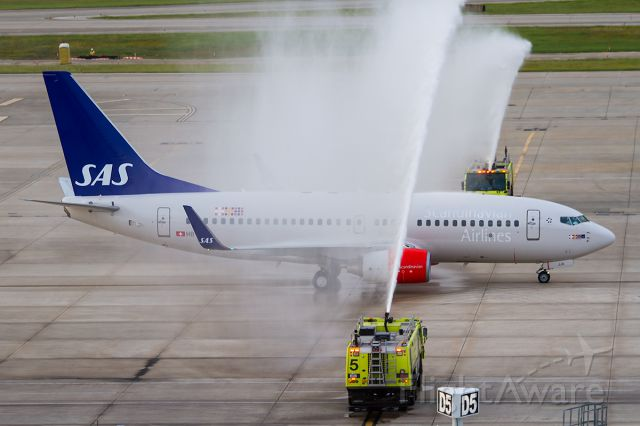 Boeing 737-700 (HB-JJA) - welcome the flight with a water canon salute