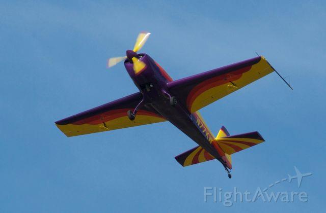 N77KW — - 1997 Extra EA-300/L aerobatic, airborne at LaPort Texas - T41