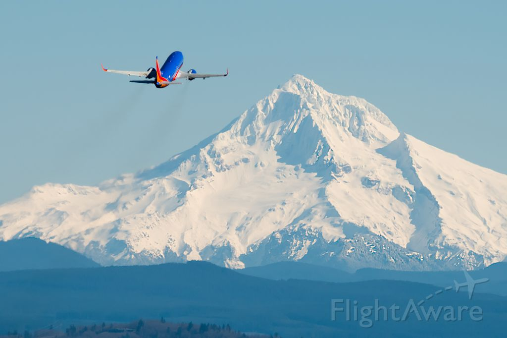BOEING 737-300 (N368SW) - Southwest B737-300 departs Portland on a Beautiful day.  This is not faked, all I did was crop it, sharpen it and put some contrast.