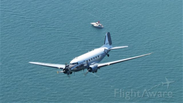 """Douglas DC-3 (N8704) - Yankee Air Museum's C-47 Skytrain, orbiting Lake St Clair awaiting photo pass at the 2017 Selfridge Open House, celebrating 100 years of aviation history. This shot was taken from the Air Museum's B-25D """"Yankee Warrior"""""""