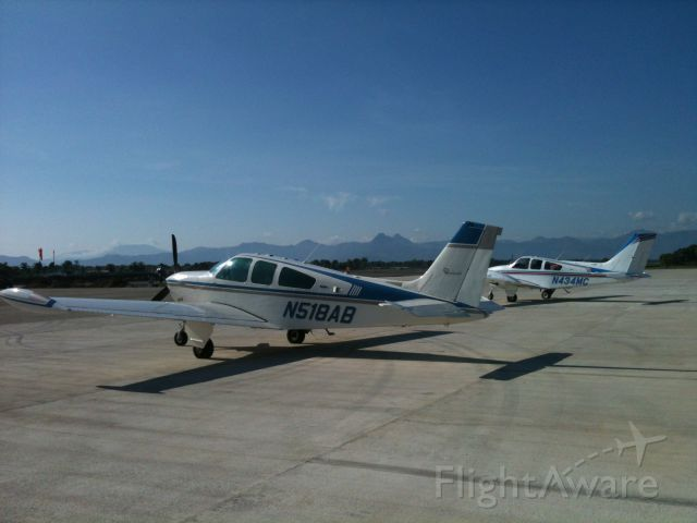 Beechcraft 55 Baron (N434MC) - N434MC and N518AB at MTCH, Cap Haitian International