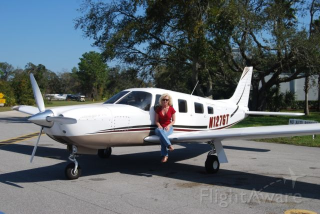Piper Saratoga (N127GT) - The Air Boss poses with our Saratoga at Spruce Creek.