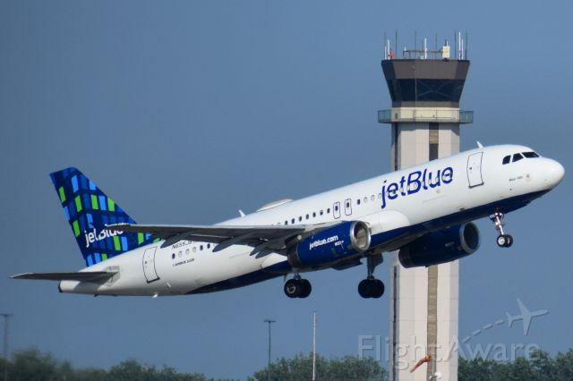 """Airbus A320 (N655JB) - JetBlue Airbus A320 """"Blue 100"""" departing the Buffalo Niagara International Airport (BUF) for New York City (JFK)<br /><br />- 100th Airbus A320 delivered to JetBlue"""