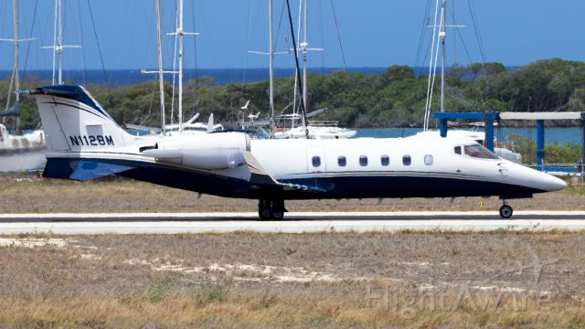 N1128M — - taxiing on the runway for backtrack.