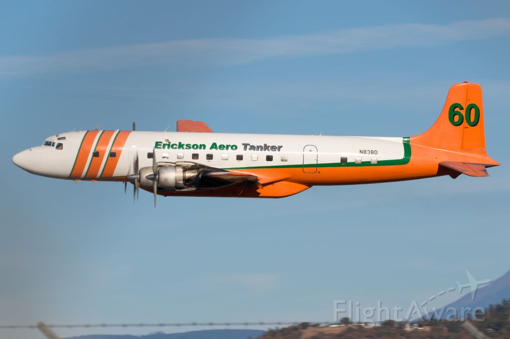 Douglas DC-7 (N838D) - Departing Medford back to Madras after completing their final season of fire fighting.