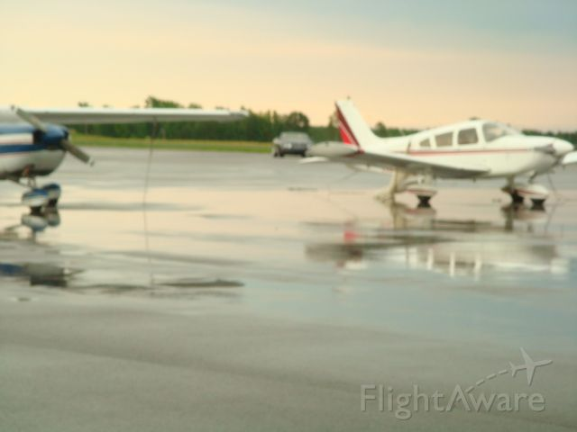 — — - After a Sunday afternoon rain at the NLR airport. Notice the Bentley in the back ground.