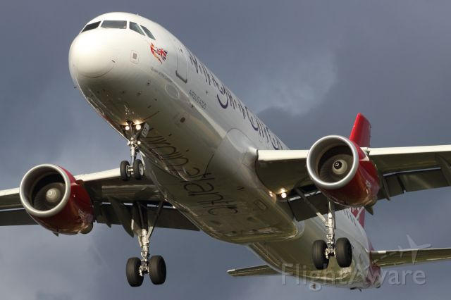 Airbus A320 — - The now defunct, Virgin Red, A320 approaches EGLL.