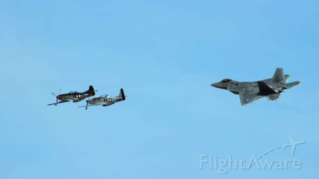 — — - Two Mustangs and a Raptor practice formation flying at Davis-monthan for Heritage Flights.