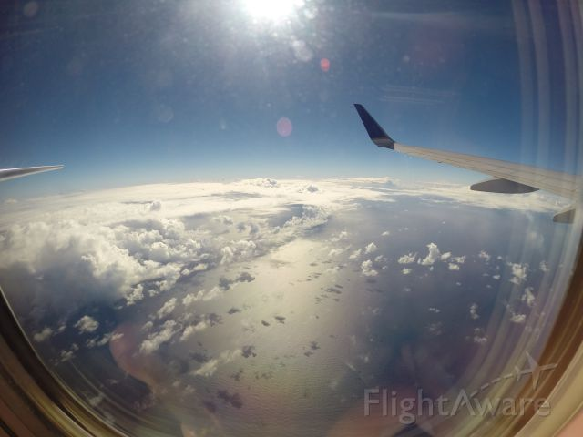 Boeing 737-700 — - Just a neat fisheye lens picture of the wing and elevator on a nice flight back from SXM