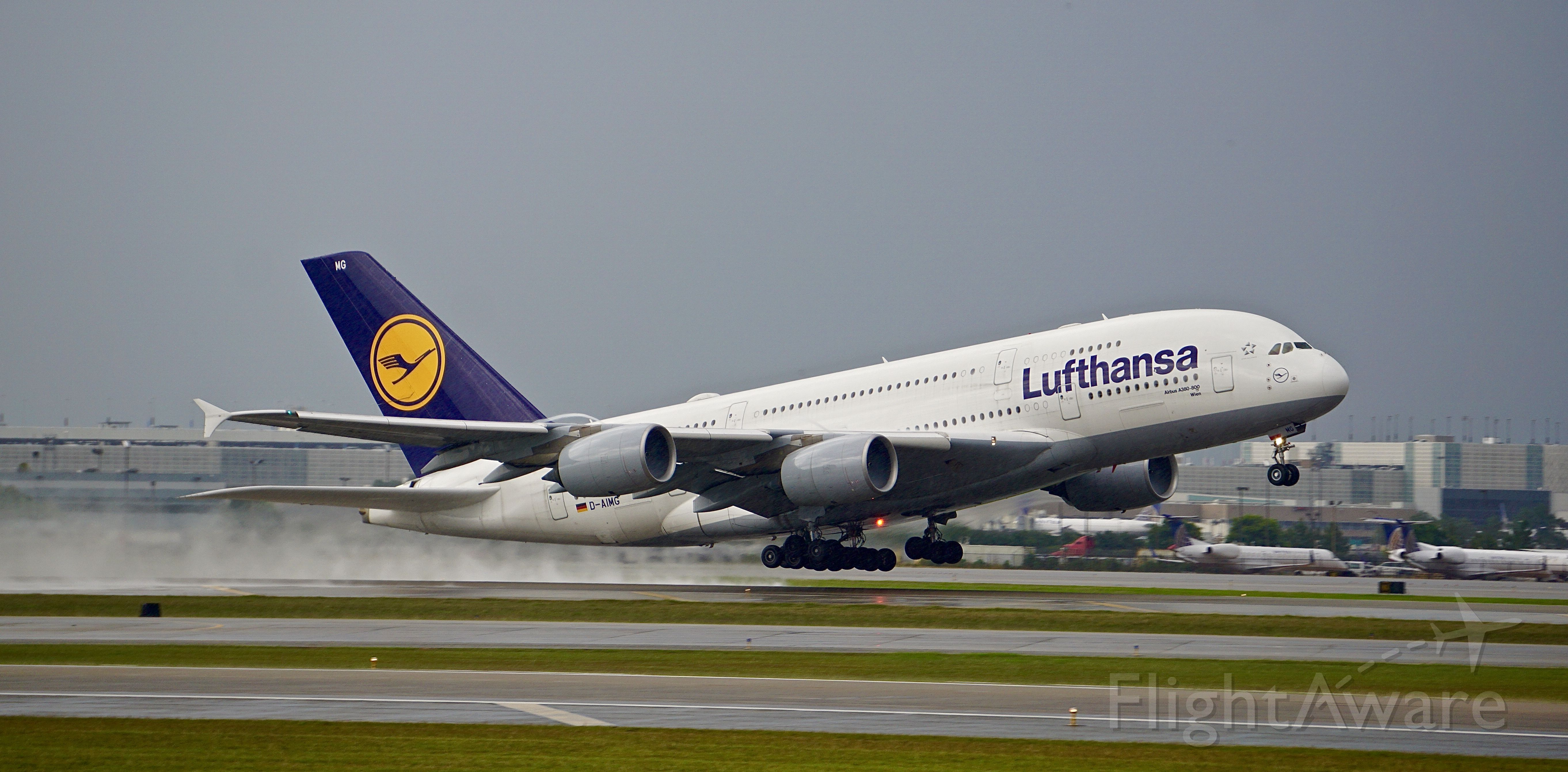 Airbus A380-800 (D-AIMG) - LH441 departing for Frankfurt on a dismal day in Houston.