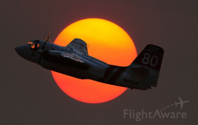 N445DF — - Tanker 80, A CDF S-2A N404DF c/n 455, departs and climbs through the setting sun on one last drop on the Butte fire from One-Six McClellan, Sacramento, Ca.