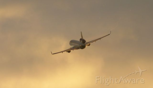 Boeing MD-11 — - A Lufthansa Cargo (unknown reg) taking off from FRA's center runway in the evening.