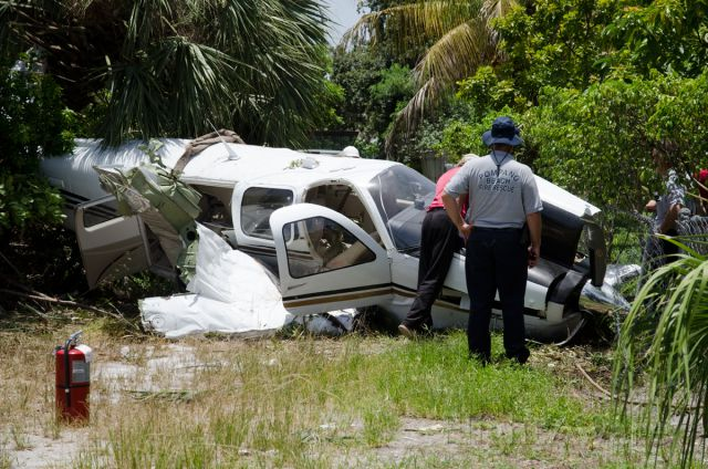 Beechcraft Bonanza (36) (N7513) - Veteran pilot James Smith was able to walk away with nary a scratch from this early morning incident west of KPMP.  Though the $670K aircraft was a total loss, he managed to navigate it ten yards short of occupied adjacent residences.