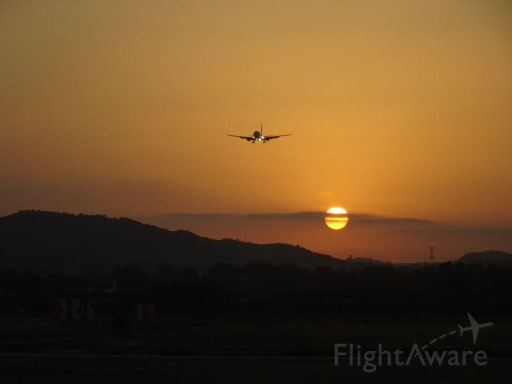 Boeing 737-800 (TRA118) - Watching our colleagues land during sunset Taken from holding point runway 12.