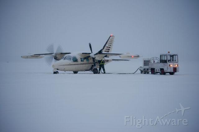 Mitsubishi MU-2 (N750CA) - Heading across the pond on a snowy day.