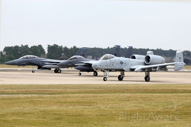 — — - On deployment to the UK in 2015, an A-10 taxiing behind a pair of Eagles as they get their last checks.