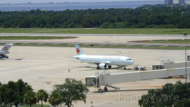 Airbus A321 (C-FDQV) - Pushing back from gate in Tampa