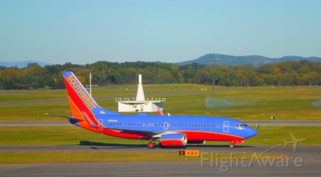 Boeing 737-700 (N969WN) - A Southwest Airlines 737 taxiis to gate C2 after arriving from Tampa.