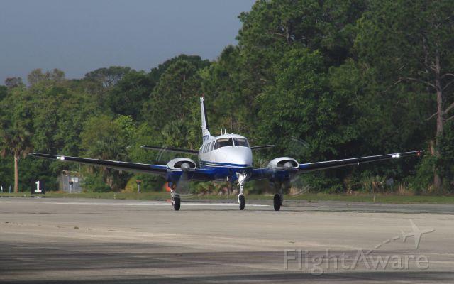 Beechcraft Queen Air (65) (C-FBOY) - Departing from Spruce Creek 2013