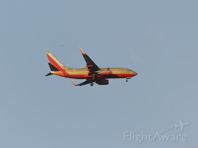 Boeing 737-700 (N714CB) - Sorry for bad quality. It was taken from my backyard.