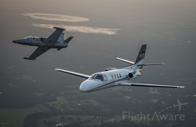 Cessna 500 Citation 1 (N1TW) - L-39 breaking formation with Citation. photo by Glenn Watson Mach Point One Aviation