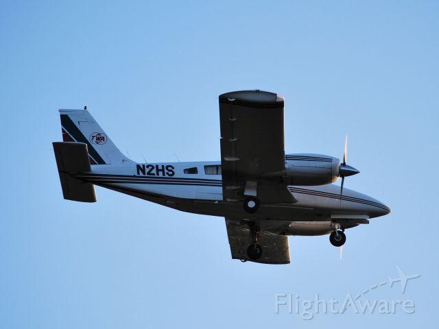 Piper Seneca (N2HS) - On final for runway 28 at SVH (photo taken from #18 fairway at Lakewood GC) - 11/20/09