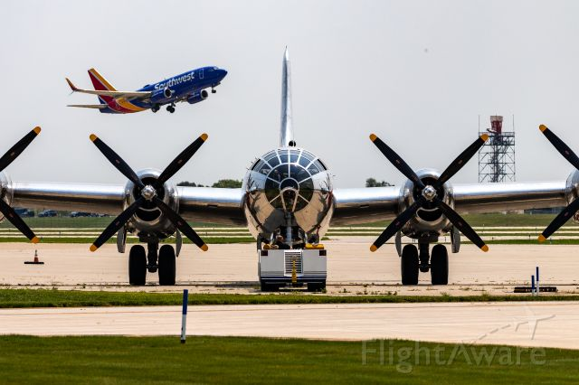 Boeing B-29 Superfortress (46-9972) - A Southwest 737 departs KGRR with Doc, a B29 Superfortress, in the foreground