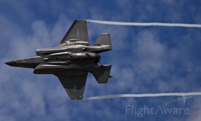 16-8727 — - US Marine F-35B pulling streamers in a tight turn in front of show center at the 2016 Farnborough airshow