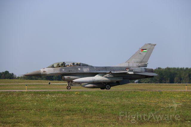 Lockheed F-16 Fighting Falcon (RJAF) - RJAF officer salutes bystanders.