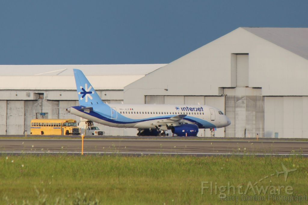Sukhoi Superjet 100 (XA-JLG) - InterJet's first SSJ sits on the ramp at Bangor Maine on its delivery flight. SN 95023, the plane is the second in the production series. It is enroute Mexico to begin revenue service following an appearance at the Paris Air Show.
