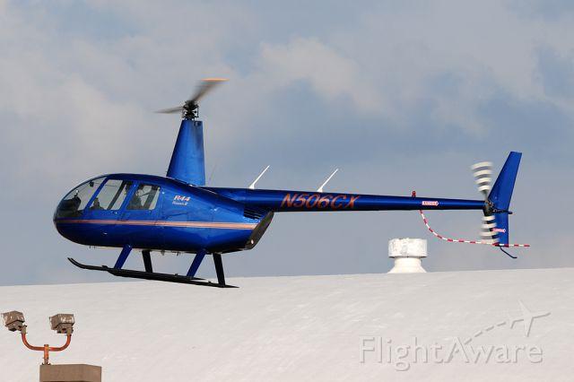 Robinson R-44 (N506CX) - Raven II landing in between the hangars.
