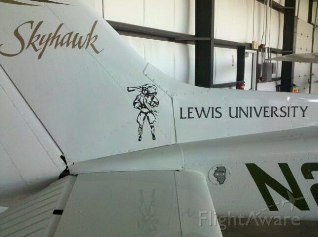 — — - Tail of a Cessna flown by the Lewis University flight program.