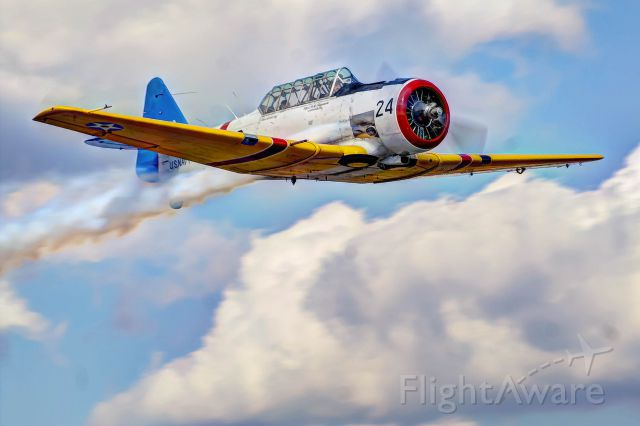 N777AP — - An SNJ owned by Joe Fagundes does a flyby at an Auburn, Alabama fly-in.