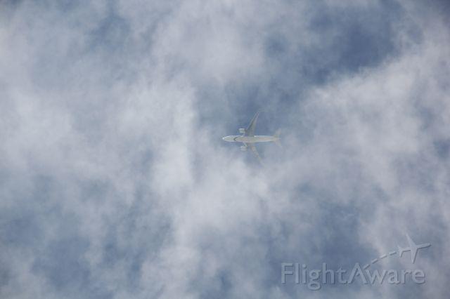 Boeing 777-200 — - Poking through the clouds descending unto KJFK
