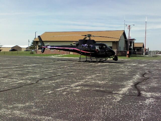 — — - A helicopter used to inspect high tension power transmission lines in and around Wisconsin/Michigan. Stopping over for a brief rest at KSUE.