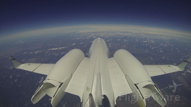 Learjet 60 (PP-BED) - Photo taken by Gopro installed in tail. FL370. The curvature of the earth is an effect of the lens, not of the altitude. Original copy, without image processing,