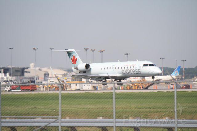 Canadair Regional Jet CRJ-200 (C-GNJA) - Arriving from Boston on runway 06R