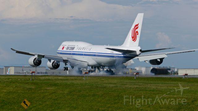 BOEING 747-8 (B-2480) - BOE72 lands on Rwy 34L to complete its B1 flight on 5/20/15. (ln 1518 / cn 41194).