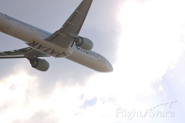 Boeing 777-200 (A7-BAB) - Real lucky shot with the sun popping out just as It took it giving it this result.