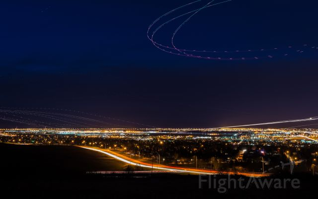 — — - As you can see, this photo contains many different airplanes.  The lights on the left are take-offs, right are landings.  The lights over head was a helicopter circling.