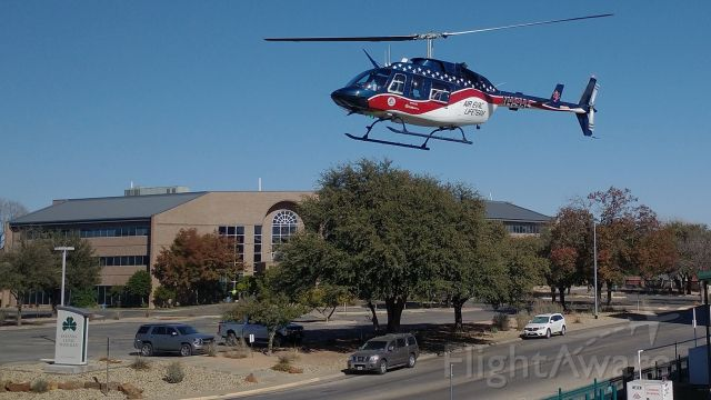 Bell JetRanger (N464AE) - Take off from Shannon Medical Center, San Angelo, Texas.