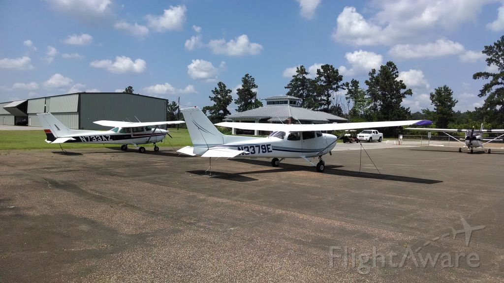 Cessna Skyhawk (N733AZ) - N733AZ and N3379E -- sister C172N models -- sit together in Cleveland. 79E made a 570 nautical mile journey to be tied down for a weekend with 3AZ.