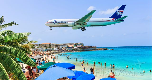 BOEING 767-300 (N396CM) - That moment every one stops what they are doing and stare at the passing metal bird. Amerijet Boeing 767 N396CM over maho beach. 23/07/2019