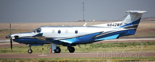 Pilatus PC-12 (N842WF) - On taxiway Foxtrot.