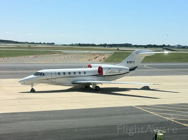 Cessna Citation X (N75TX) - Base operations next to Bravo.  In the background you can see the Ski Jump for JSF.